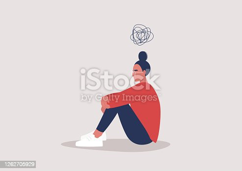 istock Young depressed female character sitting on the floor and holding their knees, a cartoon scribble above their head, mental health issues 1262705929