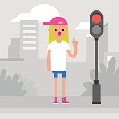 Young female character attracting attention on the pedestrian crossing / flat editable vector illustration, clip art