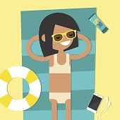 Young female character lying on the beach. Top view / flat editable vector illustration, clip art