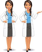 Vector illustration of a smiling young female doctor with a stethoscope, wearing a blue shirt, a dark gray skirt and a lab coat against white backround. In two poses: having her hands on her hips and holding her hand out in a presenting gesture. She is smiling or talking and looking at the camera.