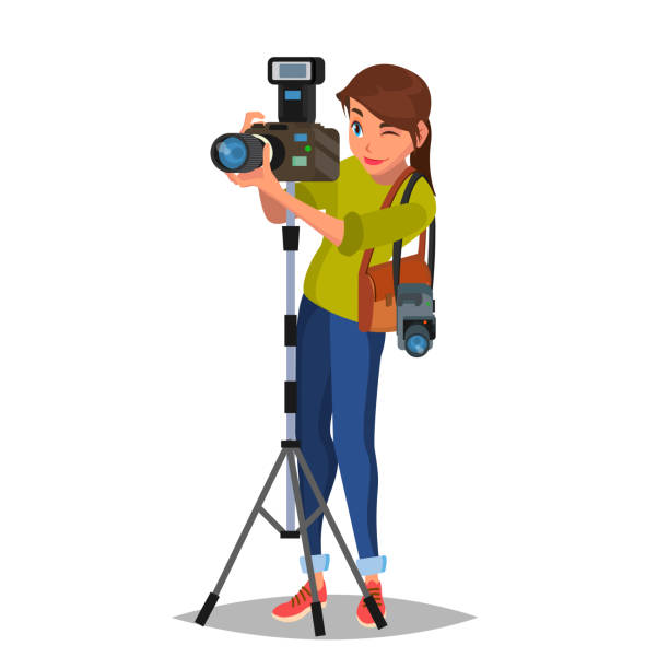young female photographer vector. take a photo. photographic equipment. holding a camera. isolated on white cartoon character illustration - fotografika stock illustrations