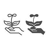 Young flower with two petals in hand line and solid icon, nature concept, spring flower blossom sign on white background, Hand holding growing flower with soil icon in outline style. Vector graphics