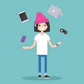 Young girl juggling electronic devices
