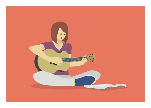 young girl playing guitar while reading a book