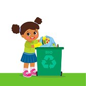 Young Girl Throwing Organic Waste In Recycle Bin. Waste Recycling.