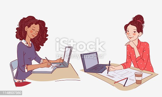 Young girl using laptop and writing in notebook