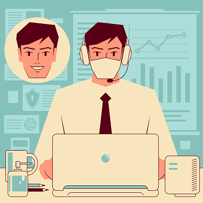 Young handsome businessman (office worker) wearing headphones and face mask using hand sanitizer working through conference calls and Web meetings or taking an online training course, e-learning and telecommuting concept