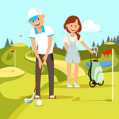 Young Happy Couple of Man and Woman Playing Golf.
