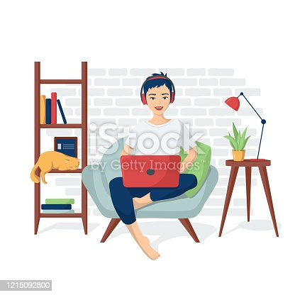 istock Young happy girl in home clothes is sitting in a chair with a laptop in headphones. Vector illustration of programmer coding, freelance. Remote work from home. Distance learning 1215092800