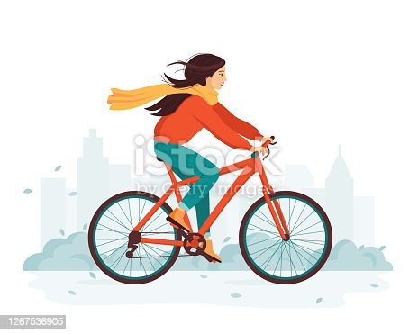 Young happy woman rides a bicycle in the autumn city. The concept of outdoor activity and healthy lifestyle in the fall. Cold season. Eco-friendly transport, vehicle. Cute cartoon vector illustration