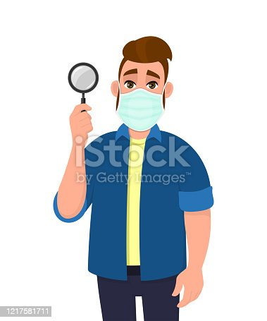 istock Young hipster man wearing medical mask and showing magnifying glass. Trendy person covering face protection from virus. Male character holding magnifier lens. Cartoon illustration in vector style. 1217581711
