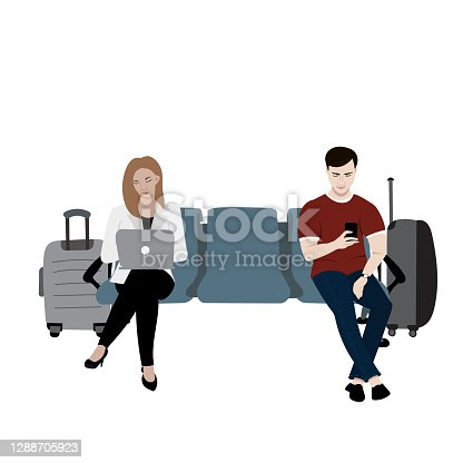 istock Young male and female sitting on the airport seats 1288705923