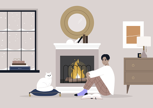 A young male Asian character sitting on the floor in front of the mantelpiece, cozy winter interior, pet friendly environment