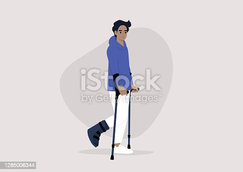 istock A young male character with a fractured leg using crutches to walk, health care 1285006344