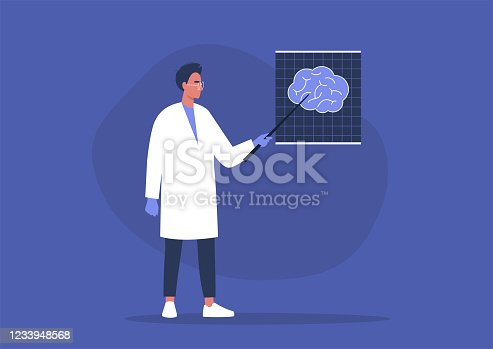A young male doctor pointing at the x-ray image of human brain, cognitive science