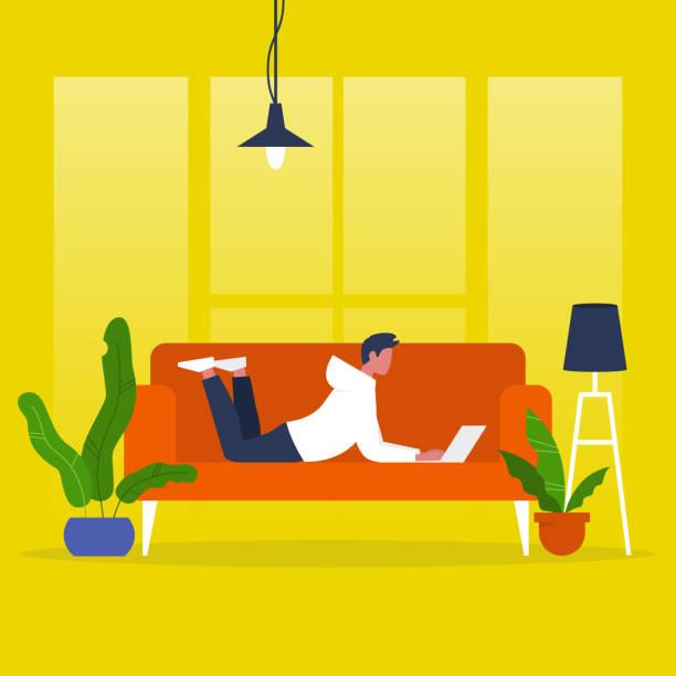 junge männliche manager mit einem laptop auf dem sofa liegend. modernes büro. freiberuflich. tägliche routine. tausendjährige lebensstil. flach bearbeitbares vektor-illustration, clipart - oberhaus stock-grafiken, -clipart, -cartoons und -symbole