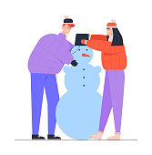 Young Man and Woman Wearing Warm Clothing Making Funny Snowman Put Bucket on his Head. Winter Time Outdoor Activity. People Playing on Christmas Holidays Vacation. Cartoon Flat Vector Illustration