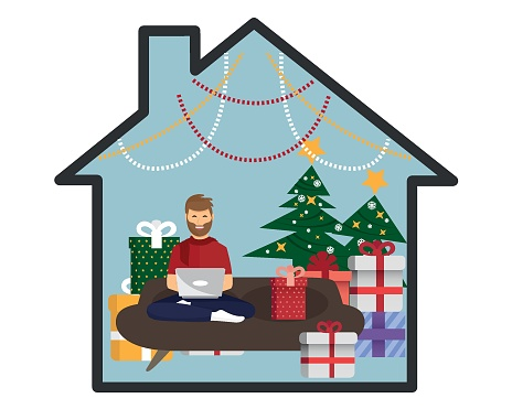 Young man celebrating Christmas at home. Is using a laptop. The house is decorated with Christmas ornaments and lights. flat modern vector.