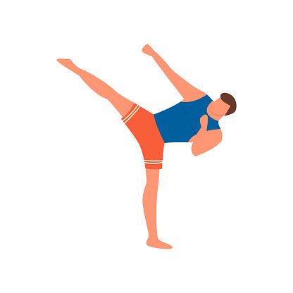 Young man do sport karate with high leg kick