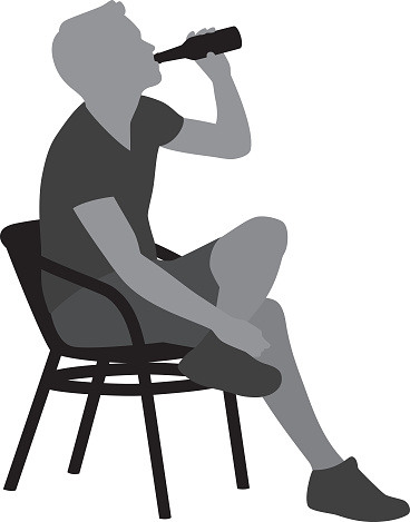 Young Man Drinking Beer in Chair Silhouette