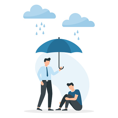 Young man holds out an umbrella from the rain to another in a state of depression. Support and help.