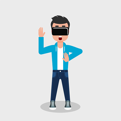Young man in jeans and sweatshirt is looking through virtual reality glasses looking scared.