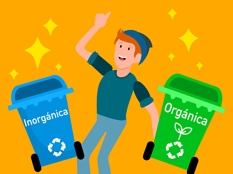 Young man inviting the separation of organic from inorganic garbage, with special garbage cans for separation and recycling, on an orange background