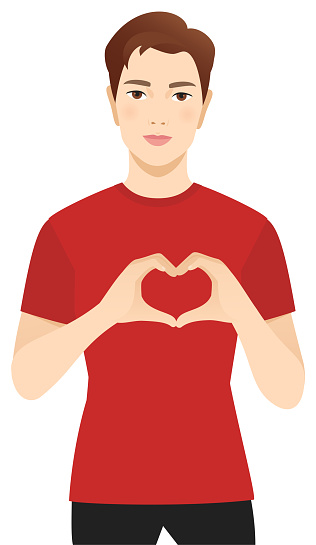 Young man making a heart shape with hands