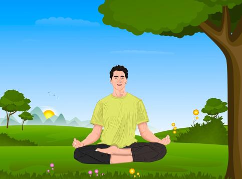 Young man meditating at park