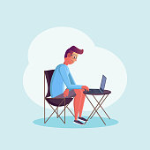 Young man sitting at the table and working at his laptop. Flat design style. Freelance worker character on isolated background