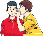 istock Young man whispering to friend. 1253232466