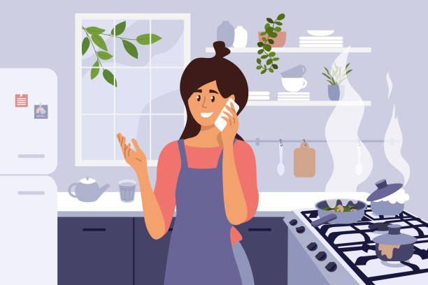 ilustrações de stock, clip art, desenhos animados e ícones de young mom cooking homemade meal, talking by phone and set kitchen fire - burned cooking