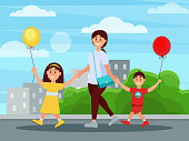 Young mother walking in park with her children. Buildings and bushes on background. Boy and girl holding balloons in hands. Family day. Happy childhood. Flat vector