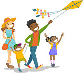 Young multiethnic family playing with a kite
