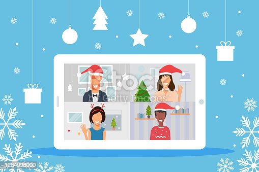 istock Young people celebrating Christmas using webcam and online meeting at home in isolation 1284998090