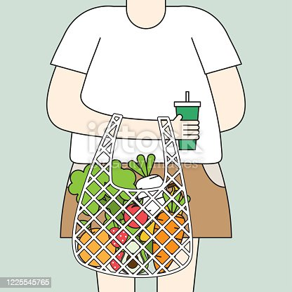 Young people stand holding a coffee cup with a net bag containing full of fresh organic fruits and healthy natural vegetables.