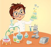 A young boy working on a chemistry experiment.