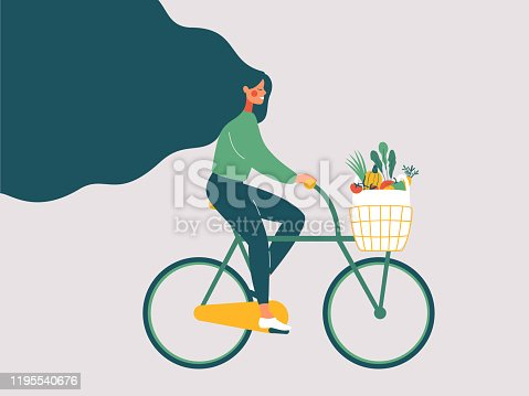 istock Young smiling girl with long hair riding bicycle with fresh vegetables in front basket. 1195540676