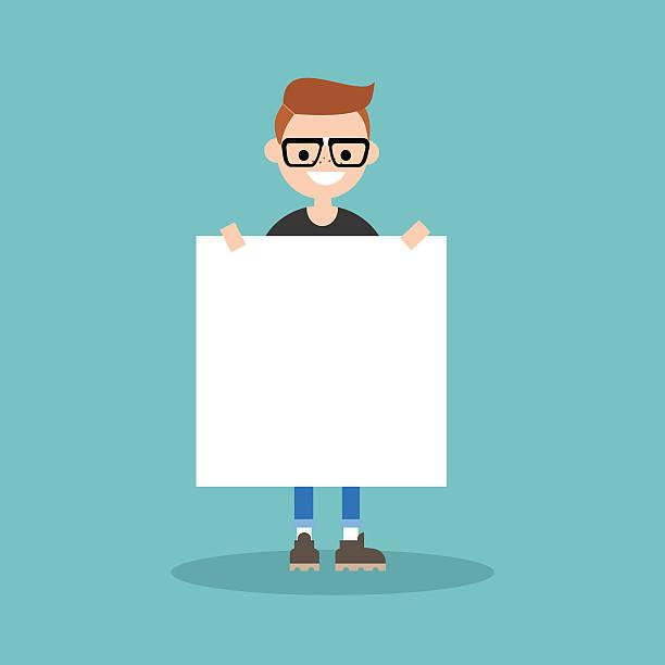 young smiling nerd holding a blank board mock up - kindersprüche stock-grafiken, -clipart, -cartoons und -symbole