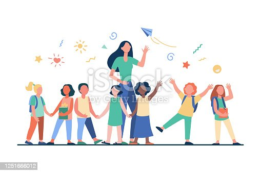 istock Young teacher with joyful kids 1251666012