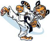 Vector cartoon of a cute young tiger cub martial artist executing a spinning back kick.