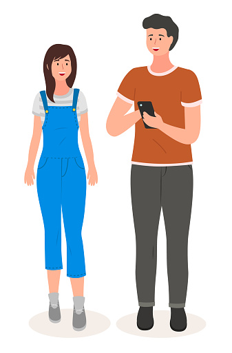 Young woman and handsome man in casual clothes standing at full height, guy holding a mobile phone
