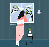 Young woman at home longing at window. Spring landscape outside, blue sky with clouds and trees. Cozy pink pajama. Self isolation concept illustration