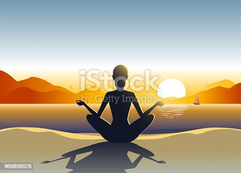 istock Young woman doing yoga on the beach 969856526