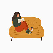 young woman dressed in a warm sweater sits on the couch and reads a book. The girl is resting at home and drinking coffee. Character vector illustration