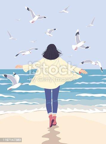istock Young Woman Enjoy the Sea Coast 1197147383
