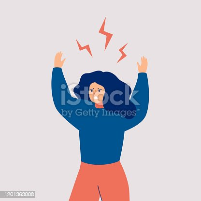 istock A young woman holds up her hands and screams in rage. 1201363008