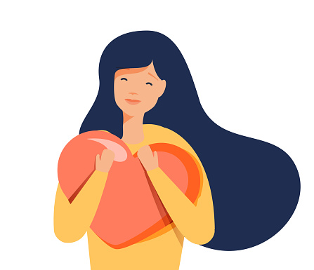 Young woman hugs a big heart with love and care. Girl with long hair holds pink heart in her hands. Self care, body care