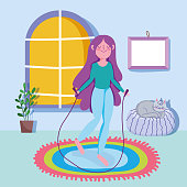 istock young woman jumping rope activity sport exercise at home 1216034626