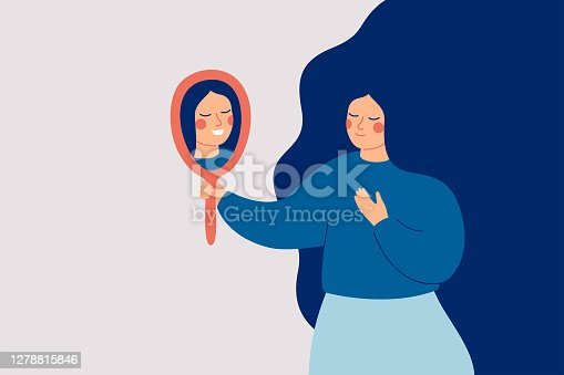 istock Young woman looks at the mirror and sees her happy reflection. 1278815846